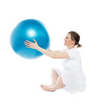 Pregnant woman sitting with exercise ball Royalty Free Stock Photography