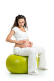 Pregnant woman sitting on fitness ball Royalty Free Stock Image