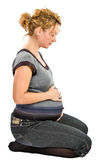 Pregnant woman sitting on the floor Stock Photo