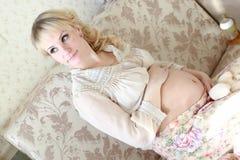 Pregnant woman sitting near the window Stock Photo