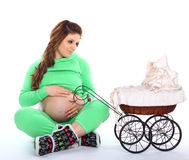 Pregnant woman sitting next to a carriage Royalty Free Stock Photography