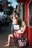 Pregnant woman sitting outside being ignored Stock Photography