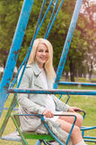 Pregnant woman sitting swing Royalty Free Stock Photography