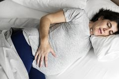 Pregnant woman sleeping on the bed Royalty Free Stock Photography