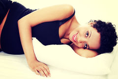 Pregnant woman sleeping on bed Royalty Free Stock Photos
