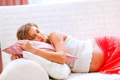 Pregnant woman sleeping on sofa Royalty Free Stock Photography
