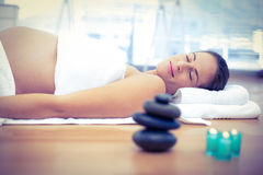 Pregnant woman sleeping in spa Stock Photography