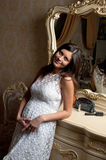 Pregnant woman smile in bedroom Stock Images