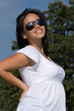 A pregnant woman smiling on a field Royalty Free Stock Photography