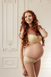 Pregnant woman smiling and standing in sexy Royalty Free Stock Photos