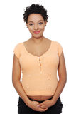 Pregnant woman smiling to the camera. Royalty Free Stock Photos