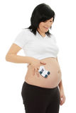 Pregnant woman with socks. Pregnant woman with baby socks isolated on white royalty free stock photo