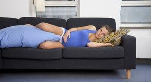 Pregnant woman on sofa Stock Photo