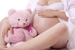 Pregnant woman with soft toy. Royalty Free Stock Photo
