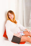 Pregnant woman with soft toys Stock Photography