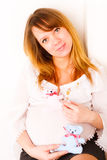 Pregnant woman with soft toys Royalty Free Stock Image