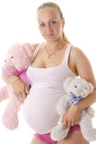 Pregnant woman with soft toys. Royalty Free Stock Images