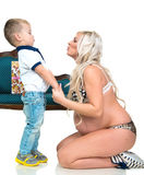 Pregnant woman with son Royalty Free Stock Photos