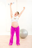 Pregnant woman in sportswear with bottle of water Stock Photography