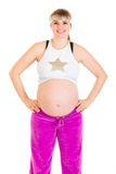 Pregnant woman in sportswear with hands on hips Royalty Free Stock Image