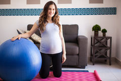 Pregnant woman with stability ball Stock Photo
