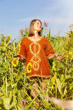 Pregnant woman standing on field Royalty Free Stock Photo