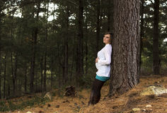 Pregnant  woman standing outdoors Stock Images