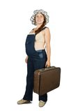 Pregnant woman  standing with suitcase Royalty Free Stock Photos