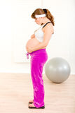 Pregnant woman standing on weight scale Royalty Free Stock Photography