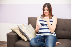 Pregnant woman stressed about pumping Stock Photo