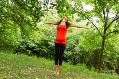 A pregnant woman stretches out his arms relaxed Royalty Free Stock Photos