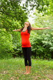 A pregnant woman stretches out his arms relaxed Stock Image