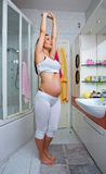 Pregnant woman stretching Stock Photo