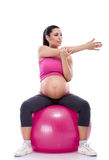Pregnant woman stretching arms Royalty Free Stock Photography