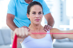 Pregnant woman stretching exercise band Royalty Free Stock Image