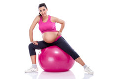 Pregnant woman stretching legs Royalty Free Stock Images
