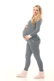 Pregnant woman in striped black and white costume Stock Photos