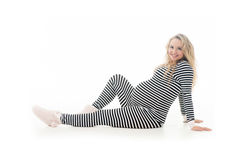 Pregnant woman in striped black and white costume Royalty Free Stock Image