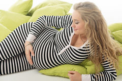 Pregnant woman in striped black and white costume Royalty Free Stock Images