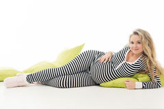 Pregnant woman in striped black and white costume Stock Images