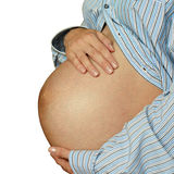 Pregnant woman in striped shirt Royalty Free Stock Photos