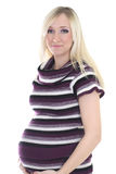 Pregnant woman in stripes dress Royalty Free Stock Image