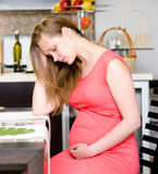 Pregnant woman with strong pain of stomach Royalty Free Stock Photo