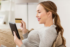 Pregnant woman with tablet pc and credit card Royalty Free Stock Photo