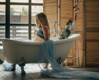 Pregnant woman takes a bath stock images