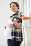 Pregnant Woman Taking Break Whilst Decorating Nursery Stock Photos