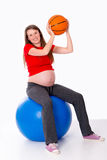 Pregnant woman taking exercise Royalty Free Stock Photo