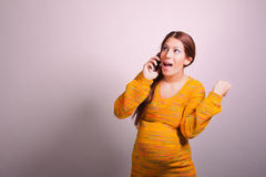 Pregnant woman talking on cell phone Royalty Free Stock Photo