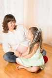 Pregnant Woman Talking with Her Daughter Royalty Free Stock Photos
