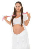 Pregnant woman with tape measure Royalty Free Stock Photo